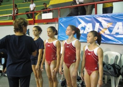 sorin with gymnast receiving medal