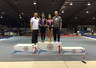 sorin with gymnast getting an award