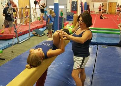 teodora working with a gymnast